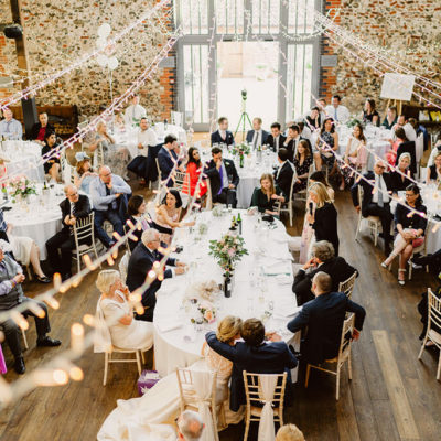 The happy couple and their guests enjoy the wedding speeches at this wedding breakfast at Oxnead Hall