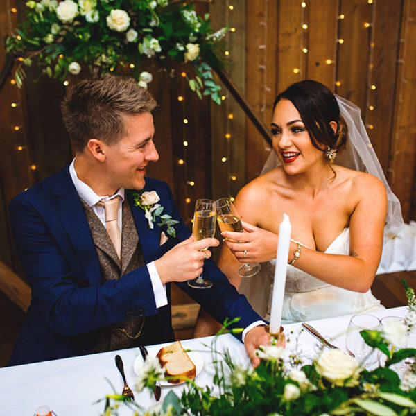 The happy newlyweds toast themselves at their wedding reception at Oxnead Hall in Norfolk