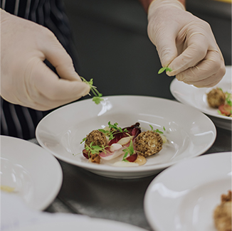 The chef prepares a delicious starter at Oxnead Hall in Norfolk